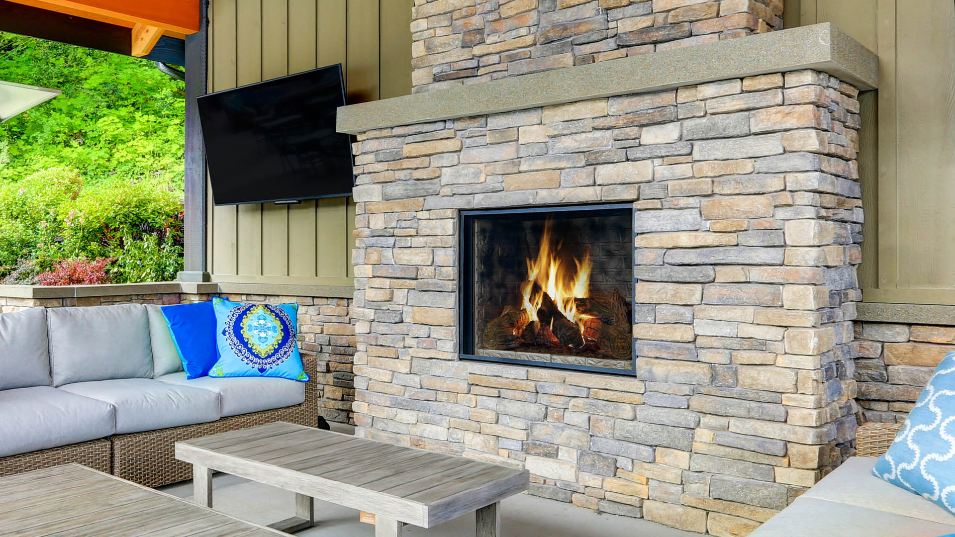 Outdoor fireplace and living areas.