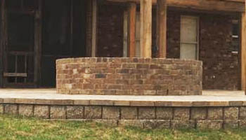 Custom brick fire pit by Ambiance Landscape for residential property in Jackson, MS.