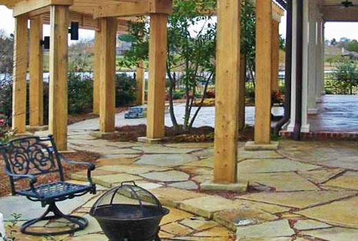 Custom stone patio hardscaping by Ambiance Landscape in Jackson, MS.
