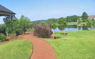 Residential home in Jackson, MS with lawn mowing service by Ambiance Landscape.