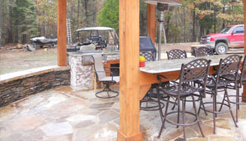 Custom outdoor kitchen with gas grill at home in Jackson, MS, by Ambiance Landscape.