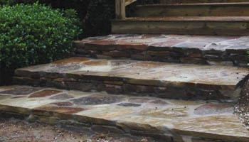 Natural stone walkway and steps installed in Jackson, MS home by Ambiance Landscape.